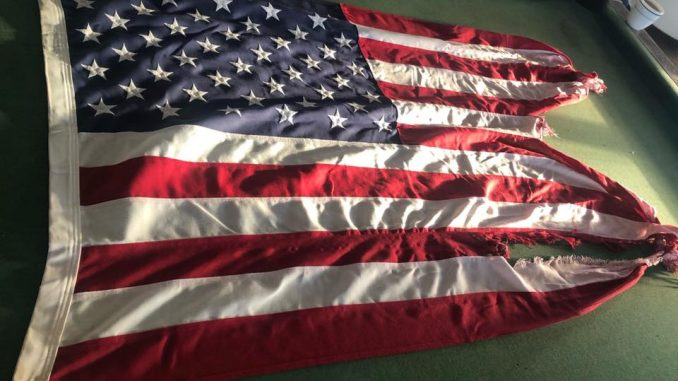 Tattered Frying Pan Tower Flag On Auction Block To Help